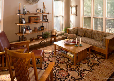 Eclectic art, Arts and Crafts furniture and a one-of-a-kind rug make an interesting combination in this eclectic home.