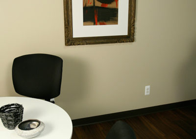 Contemporary art in a vintage frame creates a focal point in this editing suite.