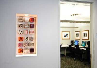 Commissioned photography and printed ceramic blocks were specified for the art of this call center.