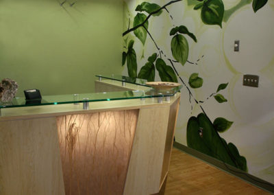 Task lighting and ambient lighting bring function and warmth to this reception area.