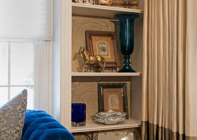 A mix of luxurious fabrics and wallpapers create an elegant backdrop for family treasures handed down for decades.