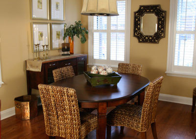 This informal dining room off of the kitchen also serves as an additional food station for parties.  Asian accents add a formality in keeping with the rest of the home, but the woven chairs keep the space less formal.