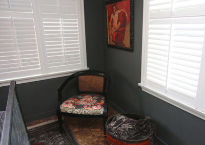 An old chair finds new life with paint and new graphic upholstery.  A flea-market piece of art is turned into something special with new framing.  And a piece found on the client's travels completes the transformation.