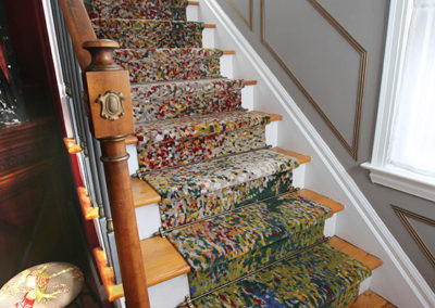 Art doesn't need to be on the walls. In this case, the custom-made hand-knotted runner is the art. The client wanted to bring a more eclectic feel to the traditional elements of the home. By adding this artistic runner, we achieved that goal.