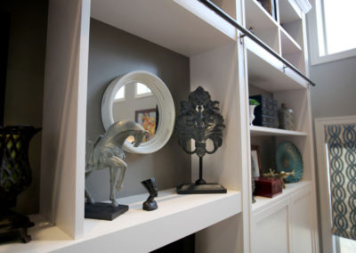 Custom built-ins add storage and display areas.  Well-placed accessories add personality and texture to the room.