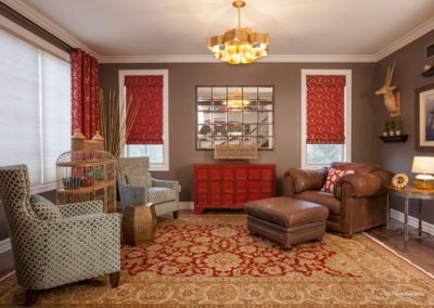 We incorporated the client's existing rug and leather chair into a sitting room. It functions as both a reading retreat as well as a place for drinks before dinner.