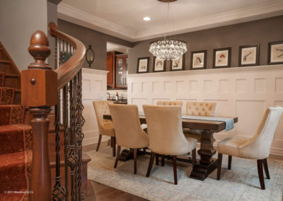 We added this unique wainscoting design to add more presence to the small dining room. The crystal chandelier adds drama as well as a beautifully fractured quality of light.