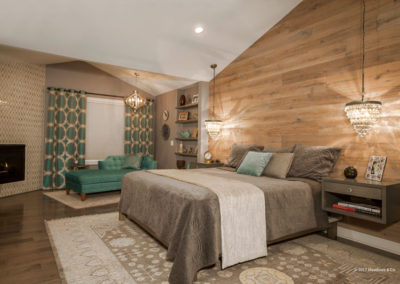 Custom accent wall, floating nightstands, crystal pendants and pops of turquoise make this master bedroom both warm and dramatic.