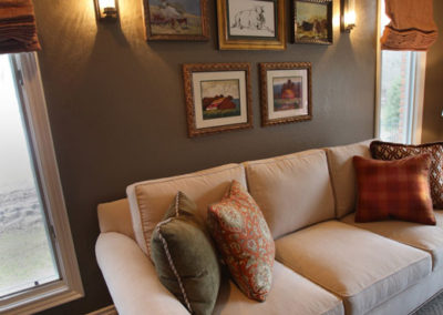 Farm-themed artwork in custom framing adds warmth to the room.