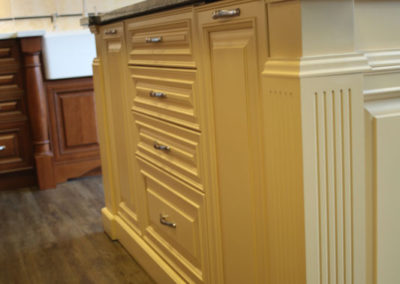 Details always add to the look of cabinetry.  Here the buttery island is accented with interesting woodworking.
