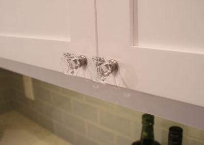 In a small space, little touches like these glass knobs, add a sense of lightness.  It seems like a small detail, but it really can add a lot to the overall design.