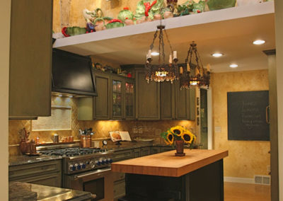 This kitchen renovation/addition took what was a tiny kitchen into an open space filled with antiques, exquisite finishes and gourmet functionality.