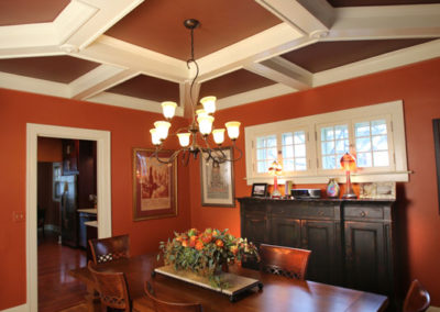 By specifying a contrast color to the white coffered ceiling detail, we made the space both warm and dramatic.