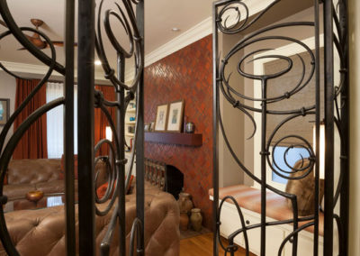 We commissioned an ironsmith to help create this Art Nouveau-inspired gate for our client's home office.