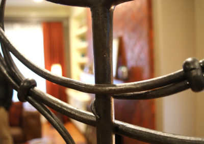 This detail shot of a gate we commissioned for our client's home office shows the level of craftsmanship involved to create what is actually a functional piece of art.