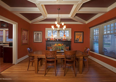 We made this dining room even more cozy by selecting a burnt-orange wall color and a darker accent color on the original coffered ceiling.