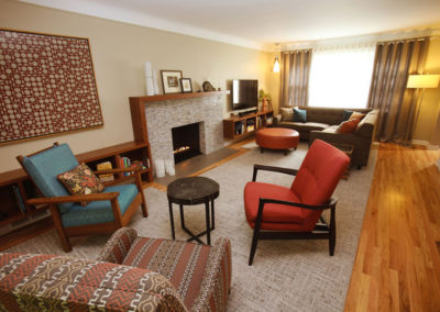 A total renovation of a mid-century inspired home, with custom built-ins and fireplace, as well as custom furnishings.