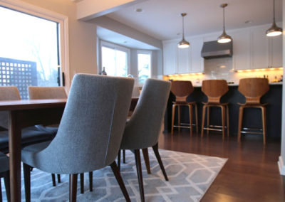 By creating a less formal dining space from an unused portion of the family room, we gave the clients an entertaining space that felt more usable while still being the chic space they were craving.  The dining table has the warmth of walnut while the chairs and light fixture bring in the crisp chic cools from the kitchen.